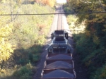 A Loaded Ore Train Heads On Down The Line